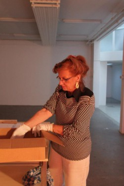 Ingrid Rollema carefully unpacking the books